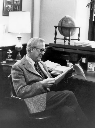 Eliot Stellar (1919-1993), working at his desk in the Provost's office