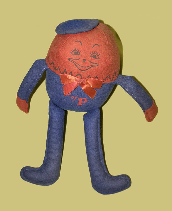 'Humpty Dumpty' style doll, made of red and blue felt, decorated with 'U of P'.